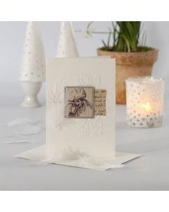 Pääsiäiskortti, johon on ommeltu koristeita ja kuviopaperia