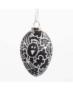 Doodlaus- tekniikalla koristeltu musta muovimuna