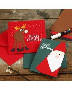 Kartonkikuviolla koristeltu joulukortti