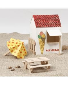 Aurinkovarjo ja piknikpöytä jäätelötikuista
