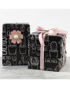 Kartonkikukka lahjapaketin koristeena