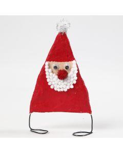Joulupukki alumiinilangasta ja kipsinauhasta. Koristeena on pompomeja.