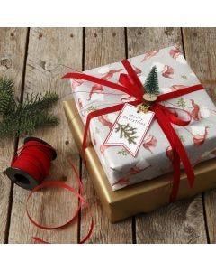 Minijoulukuusella koristeltu lahjapaketti
