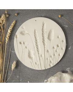 Koristeellinen lautanen ilmakuivuvasta savesta