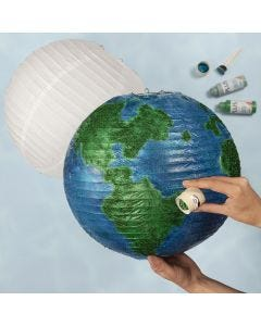 A globe from a rice paper lamp decorated with craft paint and bio glitter