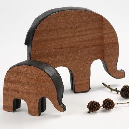 Puuvaneerilla koristellut elefantit