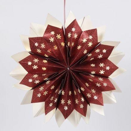 Kimaltavista paperipusseista tehty tähti, jossa on sisällä paristolla toimivat LED-valot