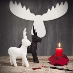 Kimaltavat porot ja kynttilänjalusta