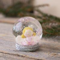 Lumisadepallo, jossa on enkeli