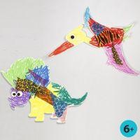 Maalattu ja koristeltu pahvi dinosaurus