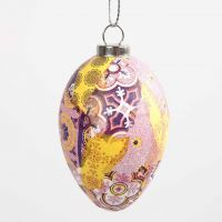 Decoupagepaperilla koristeltu pääsiäismuna.