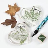 Lehdellä koristeltu lasisydän