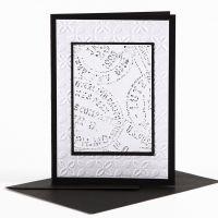 Vahaliiduilla koristeltu kohokuvoitu kortti