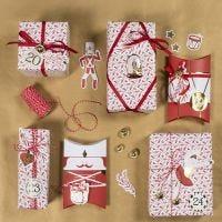 Kartonkikuvioilla koristellut lahjapaketit