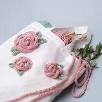 Ruusuilla koristeltu kangaskassi