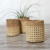 Rottingilla koristeltu nahkappaperipussi