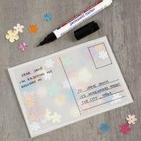 Postikortti kuultopaperista ja paljeteista