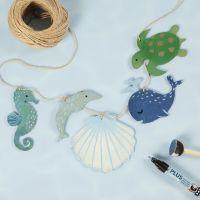 Maalatut puiset mereneläimet